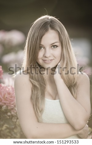 Sensual young lady smiling with her arms in her neck in vintage color - stock photo