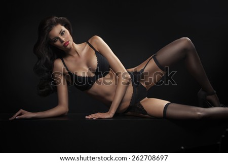 Sensual young woman wearing sexy lingerie - stock photo