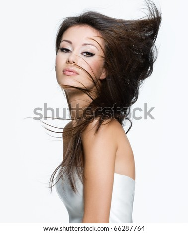 Sensual young woman with beautiful long brown hairs, posing isolated on white - stock photo