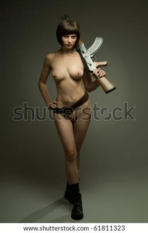 sensuality  beautifull sexy girl in military uniform, on dark background, glamour light - stock photo