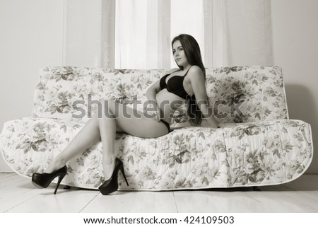 Sensuality sexy woman with perfect body at boudoir. Boudoir type shooting. - stock photo
