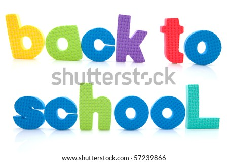 Sentence Back to school in colorful foam letters over white background - stock photo