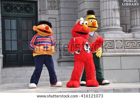 Sentosa, Singapore - June 11, 2014: Sesame Street cast members dancing in front of the visitors at Universal Studios Singapore. - stock photo