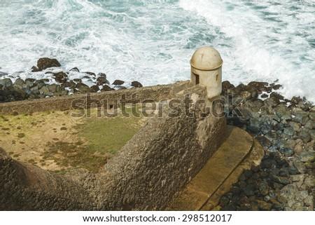 Sentry box overlooking Atlantic ocean at El Morro Fortress, San Juan, Puerto Rico - stock photo