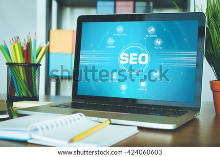 SEO chart with keywords and icons on screen - stock photo