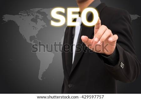 SEO concept  business man selecting virtual interface. - stock photo