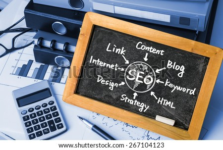 seo concept flowchart hand drawing on blackboard - stock photo