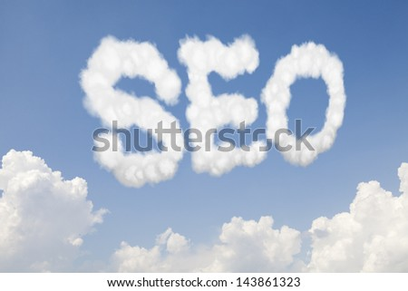 SEO search engine optimization concept text word in clouds on blue sky - stock photo