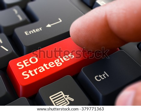 SEO Strategies - Search Engine Optimization - Written on Red Keyboard Key. Male Hand Presses Button on Black PC Keyboard. Closeup View. Blurred Background. 3D Render. - stock photo