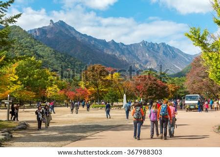 Seorak, Sokcho, South Korea - October 23, 2013: Tourists at the entrance of Seoraksan National Park, South korea  - stock photo