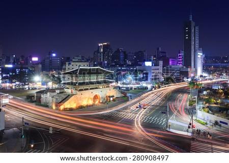 Seoul city and Dongdaemun gate (Heunginjimun), South Korea. - stock photo