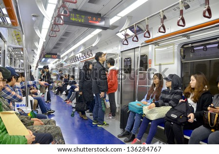 SEOUL KOREA APRIL 6 :Inside view of Metropolitan Subway in Seoul, one of the most heavily used underground system in the world, service 8 million passengers daily, on 04 06 2013, Seoul, South Korea. - stock photo