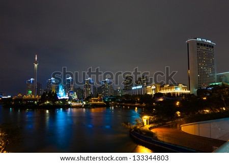 SEOUL, KOREA - AUGUST 26, 2009: High-rise apartments surround Lotte World, a Korean amusement park and major tourist destination at night in Seoul, South Korea on August 26, 2009 - stock photo