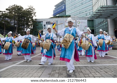 SEOUL KOREA MAY 12: People are performing folk dance for celebration of Lotus Lantern Festival on the street in front of Jogyesa Temple on may 12 2013, Seoul, Korea.  - stock photo