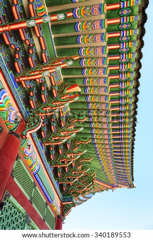 SEOUL, KOREA - OCTOBER 9, 2015 : Gyeongbokgung Palace, The beauty of the palace roof carved wood structural strength and decorated with colourful, an elegant historical architecture South Korea - stock photo