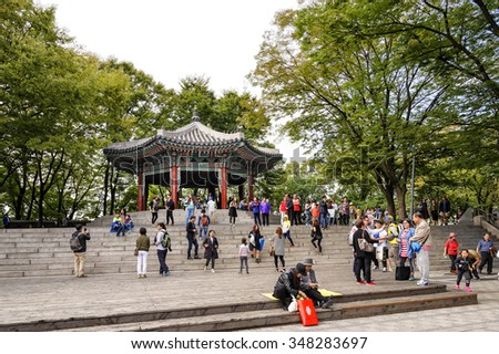 SEOUL, KOREA - OCTOBER 4, 2015 : Namsan Park, Unidentified tourists and families come to take pictures commemorate and appreciate the beauty of Seoul, an activity not to be missed when visiting here. - stock photo