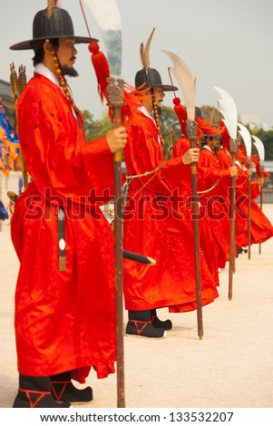 SEOUL, KOREA - SEPTEMBER 17, 2009: Row of armed guards in ancient traditional soldier uniforms protect Gyeongbokgung Palace, the old royal residence, in Seoul, South Korea on September 17, 2009 - stock photo