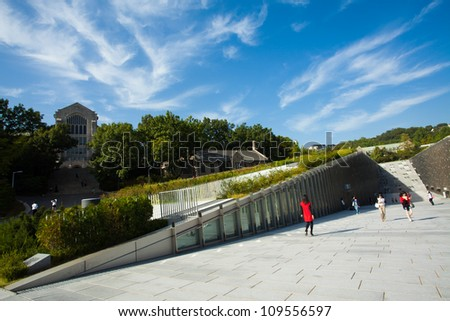 SEOUL, KOREA - SEPTEMBER 22: Students walk around the new Ewha Campus Complex, ECC, at Ewha Womans University, world's largest all female college, on September 22, 2009 in Seoul, Korea - stock photo