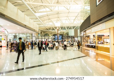 SEOUL,SOUTH KOREA - APRIL14 :People and shops are in duty free  in Incheon International Airport, the primary airport serving the Seoul National Capital Area, On April 14,2015 in Seoul South Korea.  - stock photo