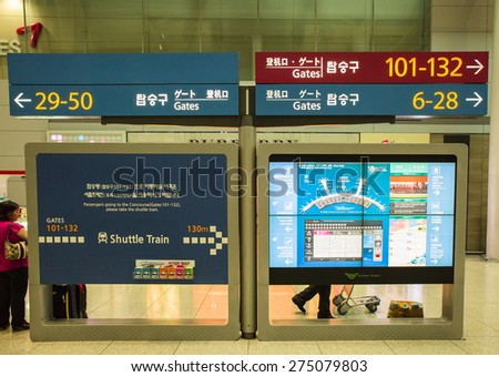 SEOUL,SOUTH KOREA - APRIL 14 : The information board is in Incheon International Airport , the primary airport serving the Seoul National Capital Area, On April 14,2015 in Seoul South Korea.  - stock photo