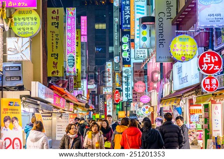 SEOUL, SOUTH KOREA - FEBRUARY 14, 2013: Crowds enjoy the Myeong-Dong district nightlife in Seoul. - stock photo