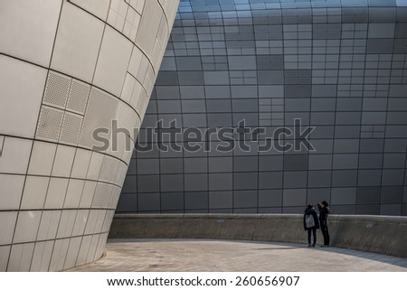 SEOUL, SOUTH KOREA - FEBRUARY 20: Modern architecture at the Dongdaemun Design Plaza. Photo taken February 20, 2015 in Seoul, South Korea. - stock photo