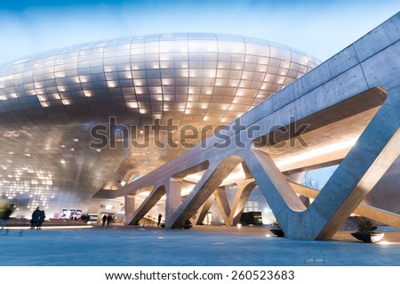 SEOUL, SOUTH KOREA - FEBRUARY 28, 2015 : Modern architecture of Dongdaemun Design Plaza at night, The building designed by Zaha Hadid and Samoo. - stock photo