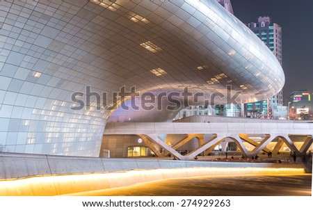 SEOUL, SOUTH KOREA - MARCH 29,2015: Dongdaemun Design Plaza at Night, New development in Seoul, designed by Zaha Hadid. Photo taken March 29, 2015 in Seoul, South Korea. - stock photo