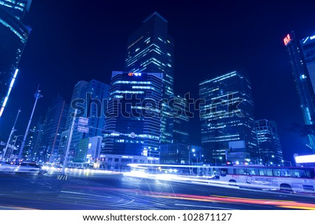 SEOUL, SOUTH KOREA - MARCH 22: Hi-rise building at nighttime in Gangnam district on March 22,2012 in Seoul, Korea. This area located several popular shopping centers and  business headquarters. - stock photo