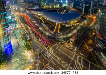 SEOUL, SOUTH KOREA - March 29:Late night traffic blurs past Dongdaemun Design Plaza, designed by the famous architect Zaha Hadid. on March 29, 2015 in Seoul, South Korea. - stock photo