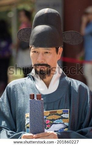 SEOUL, SOUTH KOREA - MAY 21: Duksu Palace Royal Guard-Changing Ceremony on May 21, 2013, in Seoul. This tradition is similar to the changing of the guard at Buckingham Palace in England. - stock photo