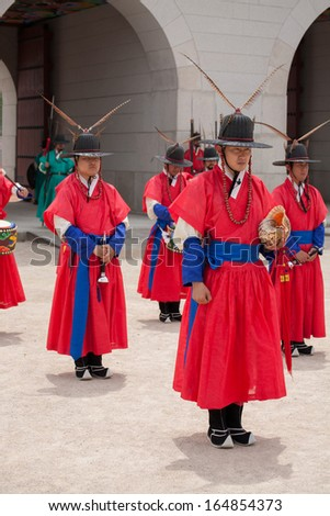 SEOUL, SOUTH KOREA - MAY 31: Kyungbokgung Palace Royal Guard-Changing Ceremony on May 31, 2013, in Seoul. This tradition is similar to the changing of the guard at Buckingham Palace in England. - stock photo