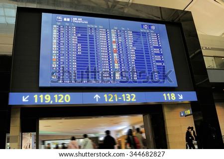 SEOUL, SOUTH KOREA - NOVEMBER 16: Flight departure board and people in departure terminal of Seoul Incheon International Airport.November 16, 2015 Seoul, South Korea - stock photo