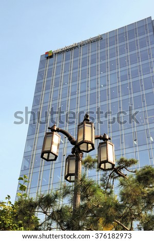SEOUL SOUTH KOREA-NOVEMBER 11: Microsoft Head Office in South Korea and at the foreground old fashioned lantern. November 11, 2015 Seoul, South Korea  - stock photo