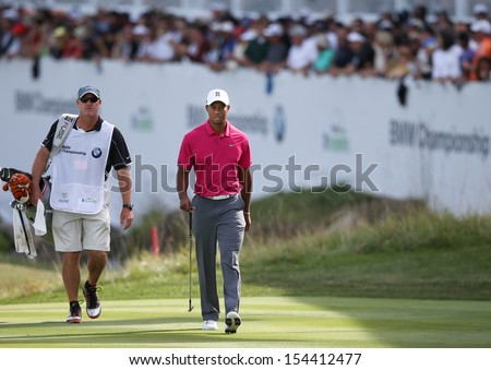 Sep 15, 2013; Lake Forest, IL, USA; Tiger Woods (r) approaches the 18th green with caddie Joe LaCava during the third round of the BMW Championship at Conway Farms Golf Club. - stock photo
