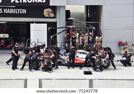 SEPANG F1 CIRCUIT, MALAYSIA - APRIL 8: Jenson Button of Vodafone McLaren Mercedes is in the pit stop at PETRONAS Malaysia Grand Prix during qualifying session on April 8, 2011 in Sepang, Malaysia - stock photo
