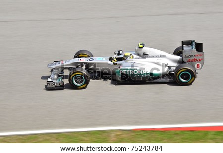SEPANG F1 CIRCUIT, MALAYSIA - APRIL 8: Nico Rosberg of Mercedes GP Petronas Team in action at PETRONAS Malaysia Grand Prix during qualifying session on April 8, 2011 in Sepang, Malaysia. - stock photo