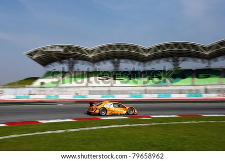 SEPANG - JUNE 19:apr team's Toyota Corolla Axio car drives by turn 1 at the Japan SUPER GT Round 3 race in Sepang International Circuit on June 19, 2011 in Sepang, Malaysia. - stock photo