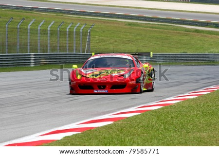 SEPANG - JUNE 17: Mok Weng Sun of Team Clearwater Racing in a Ferrari F458 takes to the tracks of the Sepang International Circuit at the GT Asia Series race on June 17, 2011 in Sepang, Malaysia. - stock photo
