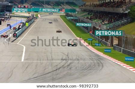 SEPANG, MALAYSIA - APRIL 23: Cars on track at race during Formula One Teams Test Days at Sepang circuit on March 23, 2012 in Sepang, Malaysia. - stock photo