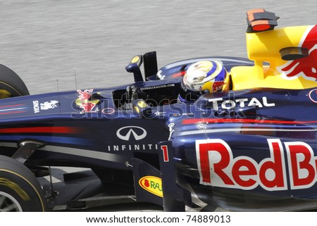SEPANG, MALAYSIA - APRIL 8: Close up Sebastian Vettel of Red Bull Racing in action at PETRONAS Malaysian Grand Prix on April 8, 2011 in Sepang, Malaysia.The race will be held on Sunday April 10, 2011. - stock photo