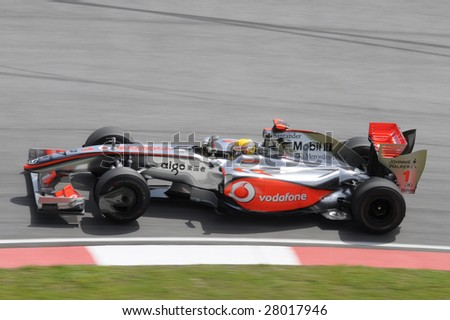 SEPANG, MALAYSIA - APRIL 3 : F1 driver Lewis Hamilton  of British races his Mclaren during the first practice session at the Sepang International Circuit April 3, 2009 in Sepang, Malaysia. - stock photo