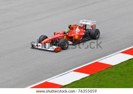 SEPANG, MALAYSIA - APRIL 8: Felipe Massa (team Scuderia Ferrari Marlboro) at first practice on Formula 1 GP, April 8 2011, Sepang, Malaysia - stock photo