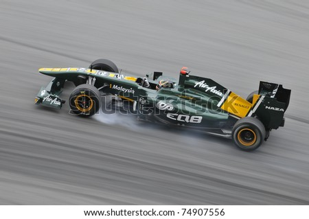SEPANG, MALAYSIA - APRIL 8: Heikki Kovalainen of Team Lotus brakes hard during practice session at PETRONAS Malaysian GP on April 8, 2011 in Sepang, Malaysia. The race will be held on April 10 - stock photo