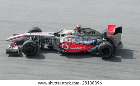 SEPANG, MALAYSIA - APRIL 3 : Lewis Hamilton of Vodafone McLaren Mercedes in action during practice session at Malaysian F1 Grand Prix April 3, 2009 at Sepang International Circuit in Sepang, Malaysia. - stock photo