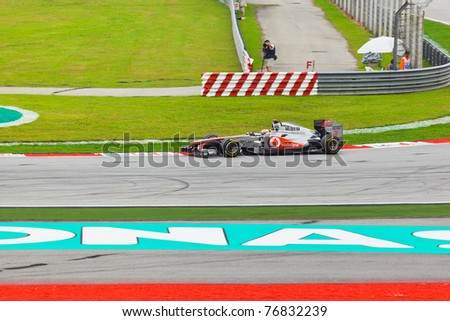 SEPANG, MALAYSIA - APRIL 9: Lewis Hamilton (team McLaren Mercedes) at qualification on Formula 1 GP, April 9, 2011 in Sepang, Malaysia. - stock photo