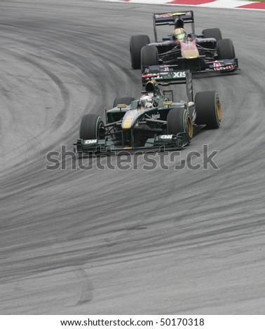 SEPANG, MALAYSIA - APRIL 2 : Lotus Racing driver Jarno Trulli of Italy drives during Petronas Malaysian Grand Prix second practice session at Sepang F1 circuit April 2, 2010 in Sepang - stock photo