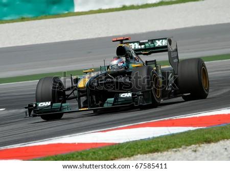 SEPANG, MALAYSIA - APRIL 2 : Lotus Team Drivers, Jarno Trulli action on track in Petronas Formula One 2010 at Sepang circuit. April 2, 2010 in Sepang, Malaysia - stock photo