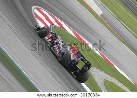 SEPANG, MALAYSIA - APRIL 2 : Red Bull Racing driver Sebastian Vettel of Germany drives during Petronas Malaysian Grand Prix second practice session at Sepang F1 circuit April 2, 2010 in Sepang - stock photo