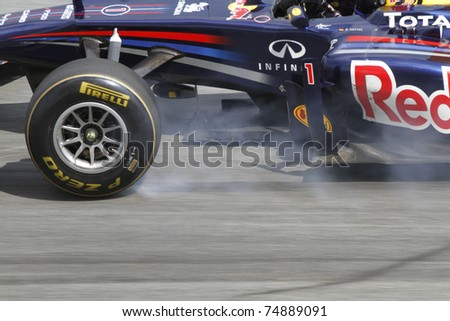 SEPANG, MALAYSIA - APRIL 8: Sebastian Vettel of Red Bull Racing brakes hard during PETRONAS Malaysian Grand Prix on April 8, 2011 in Sepang, Malaysia. The race will be held on Sunday April 10, 2011. - stock photo